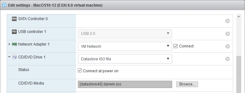 Mounting the ISO image that contains VMware Tools for macOS to a DVD drive of the VM.